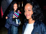 You can stand under my umbrella! Rihanna shelters a tearful young fan from the snow