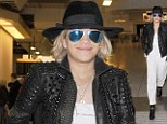 Yee-haw Ora: RIP singer Rita channels inner cowboy wearing leather boot-straps and stetson-style hat as she touches down in UK