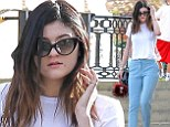 Are you even old enough to go retro? Kylie Jenner steps out in Fifties styled sunglasses and pastel blue trousers