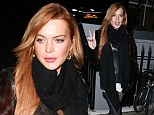 Where's the boy? Lindsay Lohan steps out without her 'British student beau', in a fur and leather jacket with lace mini skirt