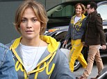 Jennifer Lopez declares 'I am happiness' in bold yellow tracksuit as she arrives for meeting with Casper Smart