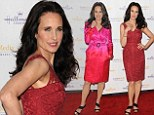 Looking Mighty Fine! Andie MacDowell whips bright pink coat off to reveal figure-hugging lace dress at Hallmark Winter Gala