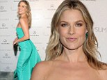 Didn't she used to be a model? Ali Larter strikes a series of awkward poses in tight teal gown at charity gala