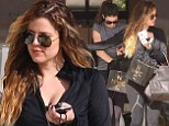 Khloe Kardashian seems to be comfortable in gym wear as she indulges in a bit of retail therapy with sister Kendall Jenner