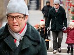 It's been a while since his last day out! Matthew Broderick grimaces through the snowy weather but it doesn't stop him from daddy duty with his adorable twin daughters