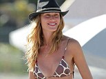 Spotted out: Olga Kent was on the beach in Miami with a friend on Sunday wearing a giraffe print bikini