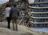 People watch the cruise liner Costa Concordia during the 'parbuckling' operation outside Giglio harbour