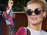 Walk on the wild side! Margot Robbie wears animal print dress while arriving at Beverly Hills hotel ahead of the Golden Globes