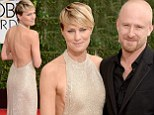 Robin Wright flashes sideboob in daring backless halter dress as she cuddles up to new fiancé Ben Foster at Golden Globes