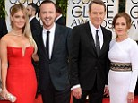 Now THAT'S a date night! Aaron Paul and Bryan Cranston are joined by their beautiful wives at the Golden Globes
