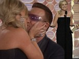 Amy Poehler kisses Golden Globe winner Bono after scooping her first ever best comedy actress gong