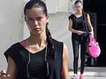 Adriana Lima looks sweaty after an intense workout session