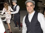 She's his Angel! Robbie Williams beams as he leaves restaurant with wife Ayda Field in tweed flat cap and studded shoes