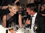 Going public? Charlize Theron sat beside Sean Penn at his Help Haiti Home event on Saturday evening in Beverly Hills
