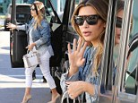 Kim K in SUV with high heels