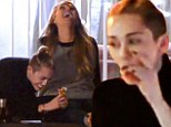 Mother daughter bonding? Miley Cyrus smokes suspicious looking cigarette at a party with her mom Tish