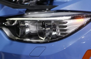 Detail view of a headlamp on the BMW M3 sedan as it is rolled out during the press preview day of the North American International Auto Show in Detroit, Michigan on January 13, 2014. REUTERS/Rebecca Cook