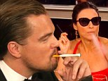 Holy smokes! Leonardo DiCaprio and Julie Louis-Dreyfus puff away INSIDE the Golden Globes... but they keep it legal with electronic cigarettes