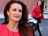Kyle Richards looks unfazed as she flashes a smile while shopping... after sister Kim is in danger of axe from RHOBH