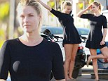 Ali Larter indulges in yoga session at the petrol station