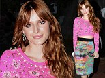 Top of the crops! Bella Thorne shakes it up in a midriff-baring pink top and paint splattered skirt for Nylon magazine party