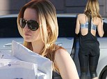 Mail run: Mena Suvari wore figure-hugging spandex on Wednesday as she picked up her mail in West Hollywood, California