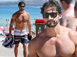 Hot: The Bachelor's Tim Robards gives beach goers a glimpse of his incredible physique as he walks shirtless through Bondi after a swim