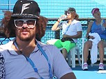 Feeling hot, hot, hot! LMFAO's Redfoo braves soaring 43 degree heat to watch his world No. 2 tennis player girlfriend Victoria Azarenka practise