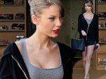Keeping it brief! Taylor Swift shows off long slim legs in tiny black shorts as she heads to dance practice looking glam