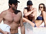 Enjoying the sights of Sydney! Shirtless Adrien Brody chats to mystery brunette beauty on Bondi Beach as he takes a break from filming
