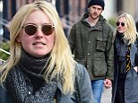 Dakota Fanning looks smitten as she walks hand-in-hand with her model boyfriend Jamie Strachan for a romantic winter stroll