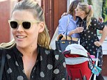 Girl talk: Busy Phillipps introduces her daughter Cricket to her Cougar Town co-star Christa Miller in Brentwood on Wednesday