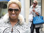 Not raining on her parade! Real Housewives' NeNe Leakes laughs as she gets wet during drizzly city stroll
