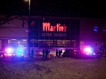 Martin's supermarket in Elkhart, which was flanked by police and fire officials after a shooting last night claimed three lives, including that of the gunman