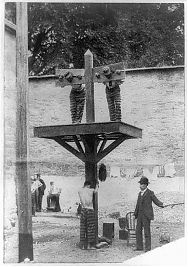 Photograph of two prisoners in a pillory