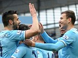 High five: Alvaro Negredo (left) congratulates Edin Dzeko following the Bosnian striker's opener