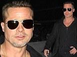 Brad Pitt with mohawk at LAX
