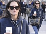 Oh, the single life! Katie Holmes enjoys a solo stroll in NYC with nothing but headphones and coffee for company