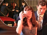 Introducing the submissive special! Jamie Dornan's Christian Grey presents Dakota Johnson's Anastasia Steele with a spanking new car as pair shoot Fifty Shades Of Grey