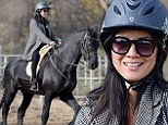 Not horsing around! Olivia Munn looks dapper while saddling up during equestrian riding lesson