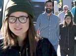 Timber! Ellen Page goes for a logger aesthetic as she brings along her very own lumberjack for a bite to eat