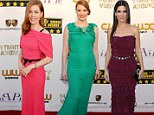 Bold and beautiful: Amy Adams, Jessica Chastain and Sandra Bullock wow in block colour floor-length gowns as they walk the red carpet for the Critics' Choice Movie Awards