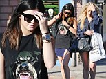Kylie Jenner wears Rottweiler muscle tee while shopping at American Vintage with a gal pal