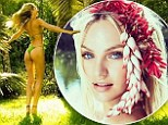 'Forest nymph!' Candice Swanepoel displays her perfectly smooth bottom as she basks among the trees in skimpy green bikini