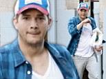 He's a fighting man! Ashton Kutcher gets rough and tumble for a Brazilian Jiu Jitsu workout