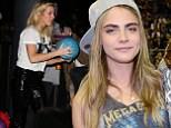 Cara Delevingne and Ellie Goulding attend basketball game and bowling launch party together