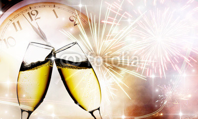 champagne glasses against clock and fireworks