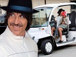 Anthony Kiedis in electric car