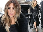 Fashion victim Kim Kardashian opts for a head to toe leather look on Parisian shopping spree