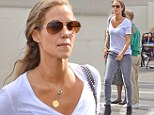 Elizabeth Berkley wears ultra-sheer top and tight grey jeans at the Beverly Hills Farmers Market